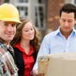 Construction: Contractor with Agents Behind — Stock Photo #25101839