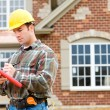 Construction: Home Inspector Checking House — Stok fotoğraf