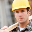Construction: Serious Worker on Home Site — Stock Photo #25101927