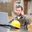Construction: Checking Something with Manager on Phone — Stock Photo