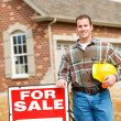Construction: Builder Stands By Sale Sign — Stock Photo