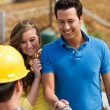 Construction: Homeowner Meeting with Contractor - Stock Photo