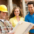 Stock Photo: Construction: Couple Reviewing Blueprints