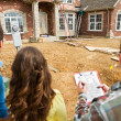 Stock Photo: Construction: Reviewing Home Checklist