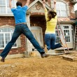 Construction: Young Couple Jumps in Excitement — Stock Photo