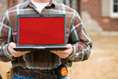 Construction: Holding Laptop with Blank Screen — Stock Photo