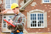 Construction: Home Inspector Checking House — Stock Photo