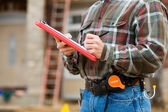 Construction: Going Down the Checklist — Stock Photo