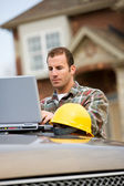 Construction: Contractor Using Laptop for Work — Stock Photo