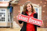 Construction: Woman Holds Up Grand Opening Sign — Stock Photo