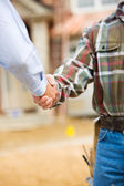 Construction: Agent and Contractor Shake Hands — Stok fotoğraf