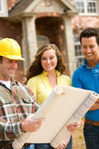 Construction: Couple Reviewing Blueprints — Stock Photo