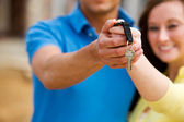 Construction: Couple Holds Out House Keys — Stok fotoğraf
