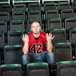 Fans: Lonely Fan Unsure of Why Team Lost - Foto Stock
