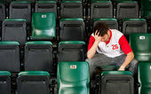 Fans: Man Sits Alone After Losing — Stock Photo