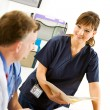 Doctors: Nurse Discussing Test Results — Stock Photo #25701417