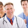 Doctors: Cheerful Senior Doctor with Nurses — Stock Photo
