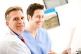 Doctors: Cheerful Doctor with Nurse — Stock Photo