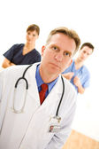 Doctors: Serious Male Doctor and Nurses — Stock Photo