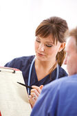 Doctors: Reviewing Test Results with Patient — Stock Photo