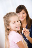 Nurse: Girl Happy to Be at Check Up — Stock Photo