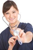 Nurse: Nurse with Stethoscope Looks at Camera — Stock Photo