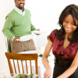 Couple: Man Setting Table with Woman in Front — Stock Photo