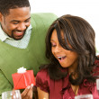 Couple: Woman Surprised By Gift at Dinner — Stock Photo #26173595