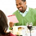 Couple: Man Gets Romantic Card — Stock Photo #26173733