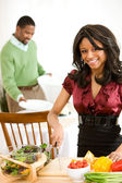 Couple: Cheerful Woman Working on Dinner — Stock Photo