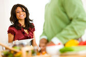Couple: Woman Sets the Dinner Table — Stock Photo