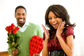 Couple: Man Brings Romantic Gifts — Stock Photo
