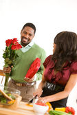 Couple: Man Has Candy and Flowers for Girlfriend — Stock Photo