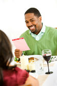 Couple: Man Gets Romantic Card — Stock Photo