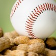 Baseball: Ball Atop Pile of Peanuts — Stock Photo