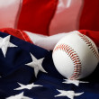Baseball: Baseball Sitting on American Flag — Stock Photo