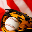 Baseball: Ball in Glove on Flag — Stock Photo