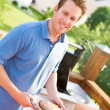 Summer: Dad Serves Up Burgers — Stock Photo