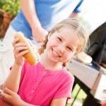 Summer: Girl Hungry for Hot Dog Dinner — Stock Photo