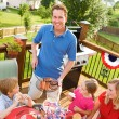 Summer: Dad Serves Up Hamburgers and Hot Dogs — Stock Photo