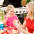 Summer: Girl Stealing Chip from Mother — Stock Photo #26308809