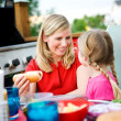 Summer: Mom Gets Hot Dog for Girl — Stock Photo #26308845