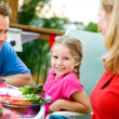 Summer: Little Girl During Family Dinner — Stock Photo #26308963