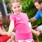 Summer: Girl Looks at Sparkler in Hand — Stock Photo