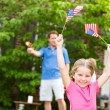 Summer: Girl In Front Yard with American Flags — Foto de Stock