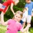 Summer: Patriotic Girl with USA Flags — Stock Photo
