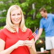 Summer: Woman with American Flag — Stock Photo #26309339