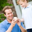 Summer: Dad Teaches Boy About Pitching — Stock Photo #26309439