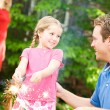 Summer: Dad Teaches Girl To Use Sparklers — Stock Photo