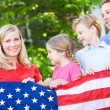 Summer: Family with American Flag — Stock Photo #26309777